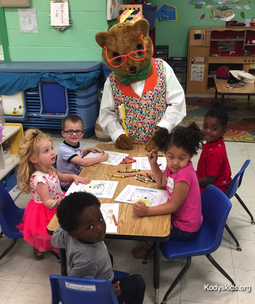 Kody helps the students with their projects at the Sussex Tech Preschool in Georgetown, Delaware. April 2019